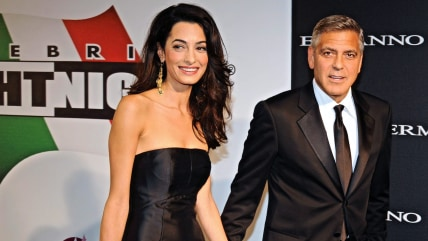 epa04389820 US actor-director George Clooney (R) arrives with his fiancee, British-Lebanese human rights lawyer Amal Alamuddin for the 'Celebrity Figh...