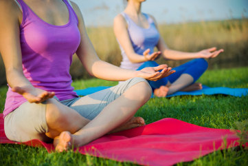 couple doing yoga outdoors; Shutterstock ID 137511098; PO: TODAY.com