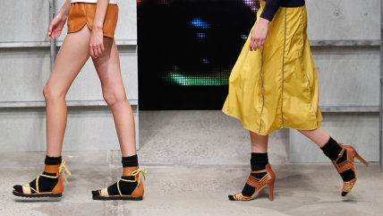 Models walks the runway wearing socks with sandals at the Band Of Outsiders Women's fashion show during Mercedes-Benz Fashion Week Spring 2014 on Sept...