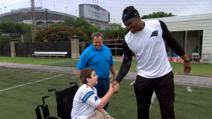 "Carolina Panthers fan Austin Smith, 13, who has cerebral palsy, meets his favorite player, Panthers quarterback Cam Newton, as part of TODAY's ""Together We Make Football"" series."