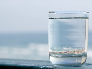 Glass of Water with Beach Reflection inside