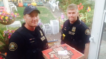 Police officers reportedly delivered a pizza after assisting a deliveryman who had been in an accident.