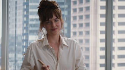 "Image: Ana makes pancakes in ""Fifty Shades of Grey"""