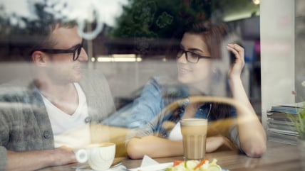 Happy man and woman in lunch time  ; affectionate; beautiful; breakfast; cafe; coffee; contempo