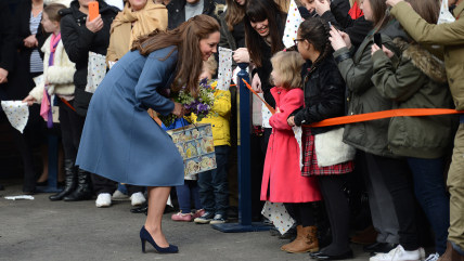 Image: Duchess Kate greets the crowd at the Emma Bridgewater factory.