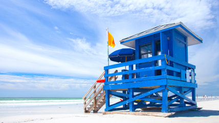 Siesta Key Beach, Florida USA, colorful lifeguard house on a beautiful summer day with ocean and blue cloudy sky; Shutterstock ID 159857432; PO: best-...