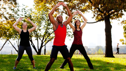 A group of people doing jumping jacks in the park; Shutterstock ID 40063717; PO: Hilary for Today