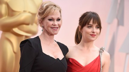 Dakota Johnson, right, and Melanie Griffith arrive at the Oscars on Sunday. (Photo by Jordan Strauss/Invision/AP)