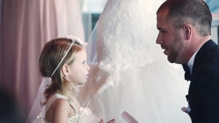 Image: Groom reads vows to bride's daughter.