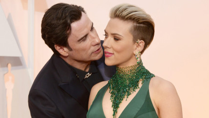 Image: John Travolta kisses Scarlett Johansson as they arrive at the 87th annual Academy Awards.