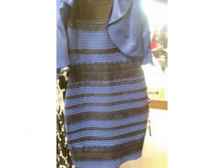 The dress is blue and black. It's just overexposed.