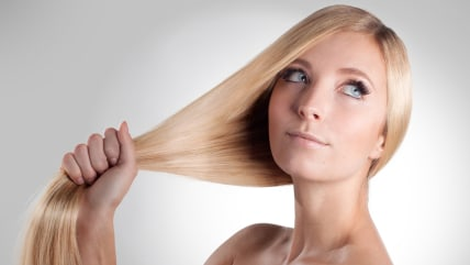 The hair check, portrait of a beautiful young blonde woman with shiny hair. ; Shutterstock ID 168498713; PO: diet-thick-shiny-hair-TODAY-150227; Job: ...