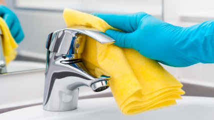 Woman doing chores in bathroom, cleaning tap; Shutterstock ID 211322881; PO: TODAY.com