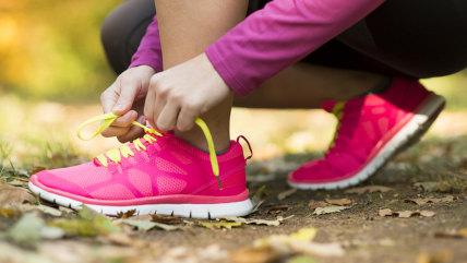 Close up of feet of a runner running in autumn leaves training exercise; Shutterstock ID 160831178; PO: Hilary for TODAY