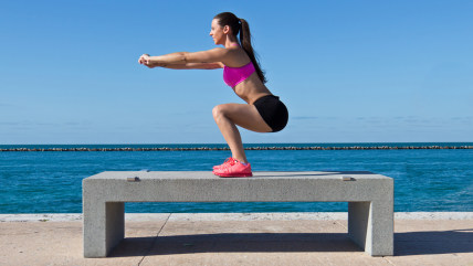 Hispanic woman doing squats on a bench by the ocean; Shutterstock ID 192407147; PO: MC for TODAY