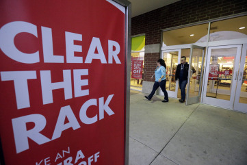Shoppers leave at Nordstrom Rack on Friday, Dec. 26, 2014, in Schaumburg, Ill.