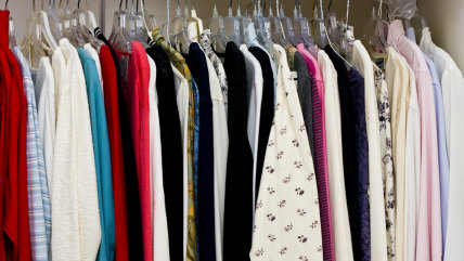Colorful women's clothing in a closet