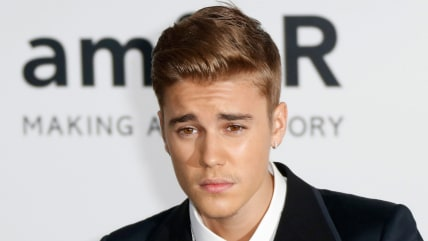 epa04219752 Canadian singer Justin Bieber attends the Cinema Against AIDS amfAR gala 2014 held at the Hotel du Cap, Eden Roc in Cap d'Antibes, France,...