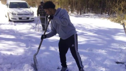 teen shoveling snow