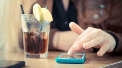 close up of woman hands using smart phones at the bar ; Shutterstock ID 196473869; PO: MC for TODAY