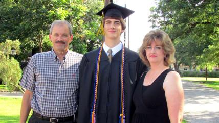 Kenny Litvik, Evan Litvik, and Amie Litvik at Evan's high school graduation.
