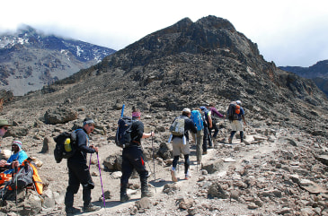 Hikers with along a trekking route at Mount Kilimanjaro, Tanzania on September 26, 2014. Mount Kilimanjaro is a dormant volcanic mountain in Tanzania....