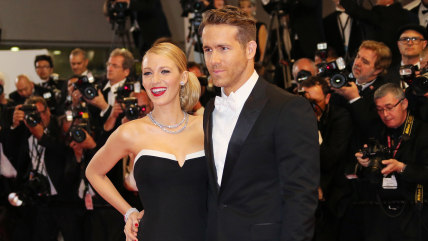 """Canadian actor Ryan Reynolds and his wife US actress Blake Lively pose as they arrive for the screening of the film """"Captives"""" at the 67th edition of ..."""