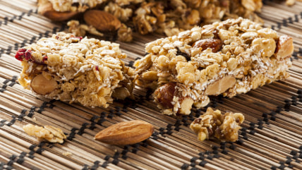 Organic Almond and Raisin Granola Bar on a background; bar; breakfast; cereal; cherry; cranberry; dessert; diet; dried; energy; flake; fruit; gourmet;...