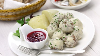 Swedish meatballs with cream gravy, boiled potatoes and lingonberry jam.
