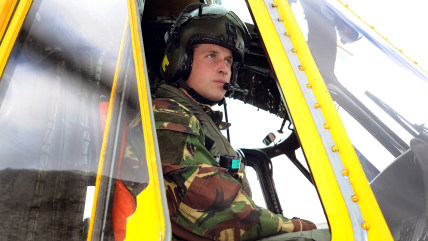 (FILES) In a file picture taken on March 31, 2011 Britain's Prince William is pictured at the controls of a Sea King helicopter during a training exer...