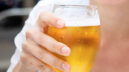 glass of light beer in hand a of woman; Shutterstock ID 198166577; PO: today.com