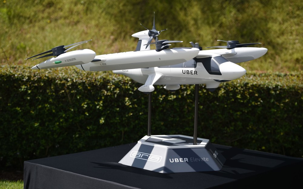 """A model of Uber's """"flying taxi,"""" an electric vertical take-off and landing vehicle, is displayed at the second annual Uber Elevate Summit on May 8 in Los Angeles. Image: Robyn Beck / AFP-Getty Images"""
