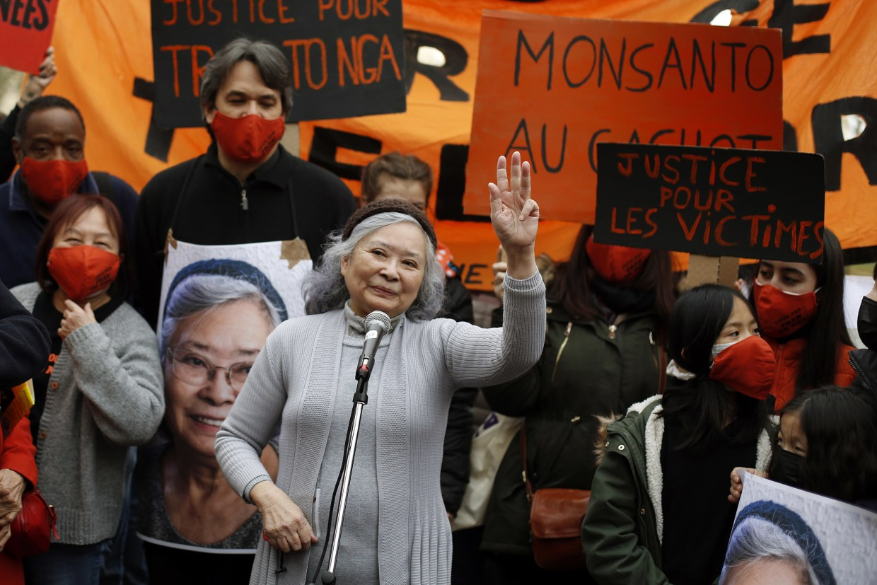 Image: Tran To Nga, a 78-year-old former journalist, waves as she delivers a speech during a gathering in support of people exposed to Agent Orange during the Vietnam War, in Paris