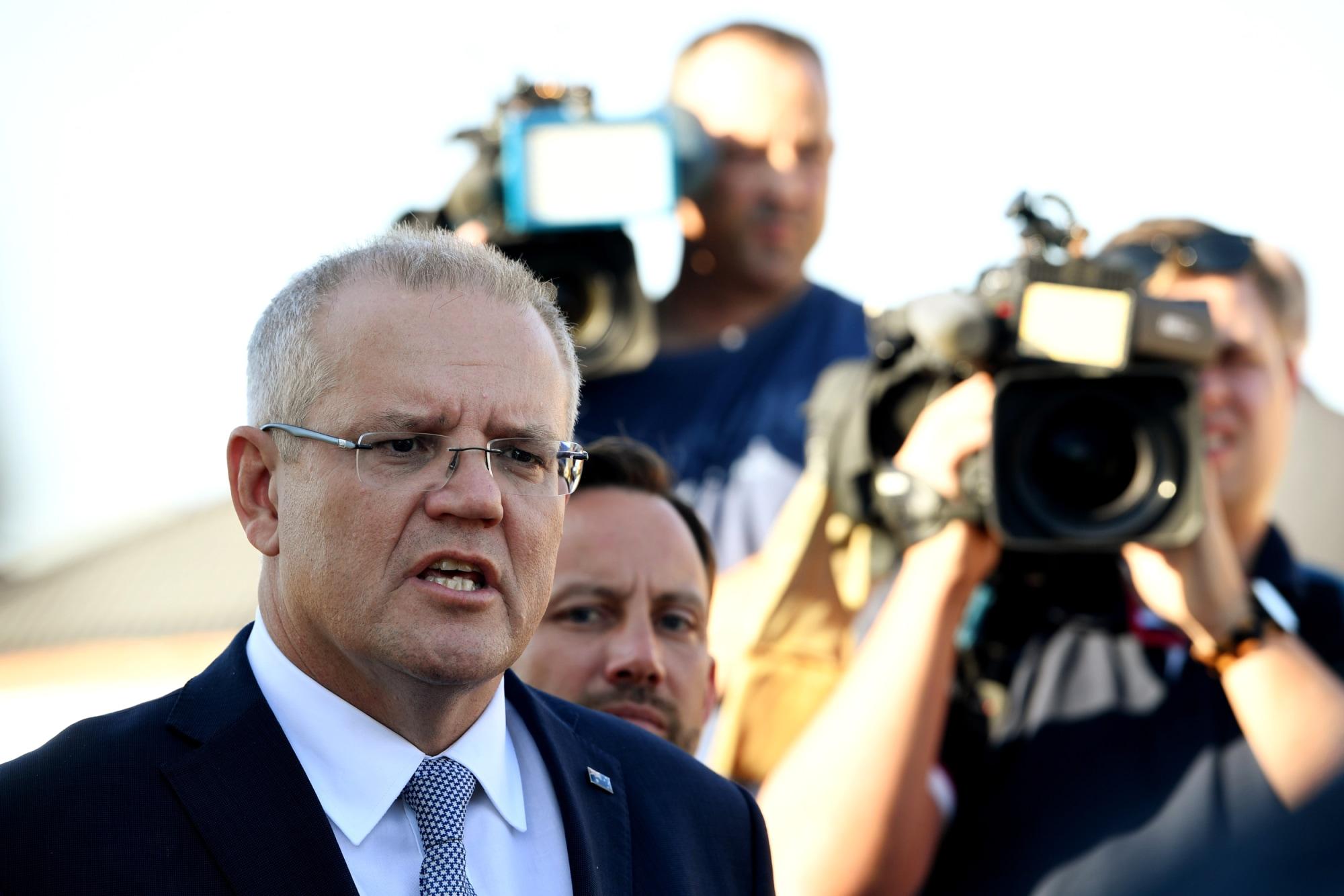 Image: Australian Prime Minister Scott Morrison speaks to the media in Perth on May 13, 2019.