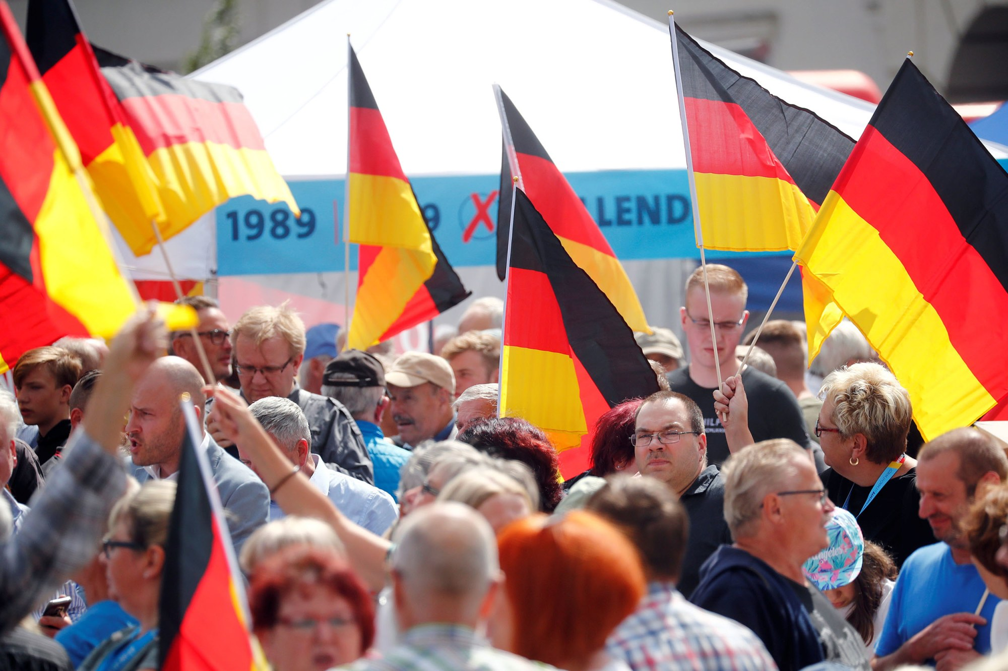 Image: People attend an election campaign event by Germany's far-right Alternative for Germany (AfD) party in Cottbus,