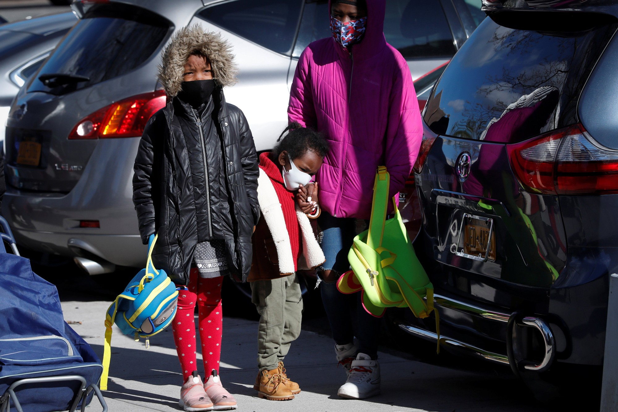 Children wait in line to pick up packages of free food during a food rescue operation run by City Harvest during the outbreak of the coronavirus in the Bronx, N.Y. on April 22, 2020.Mike Segar / Reuters