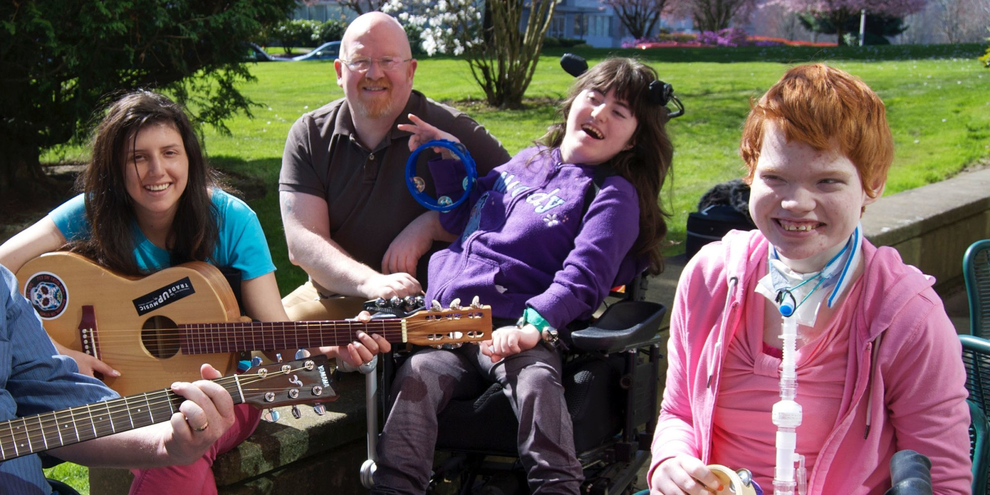 Stephanie McDonald plays the guitar for Brett Bigham and some of his previous students, including Joann Guenther and Molly Fowler.Mark Skolnik courtesy of Multnomah Education Service District