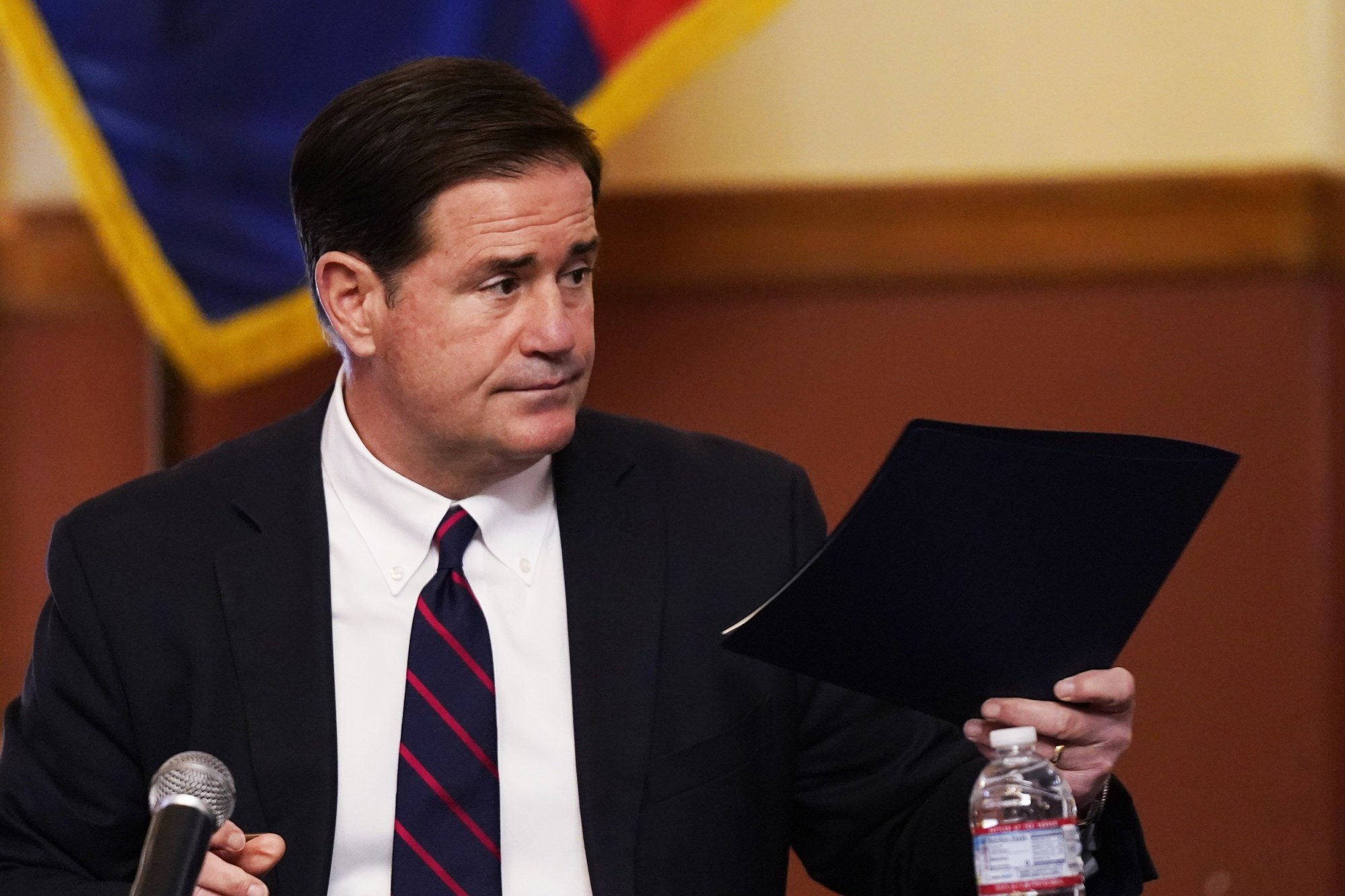 Arizona Governor Doug Ducey rolls back several COVID-19 safety measures like masks and dining restrictions