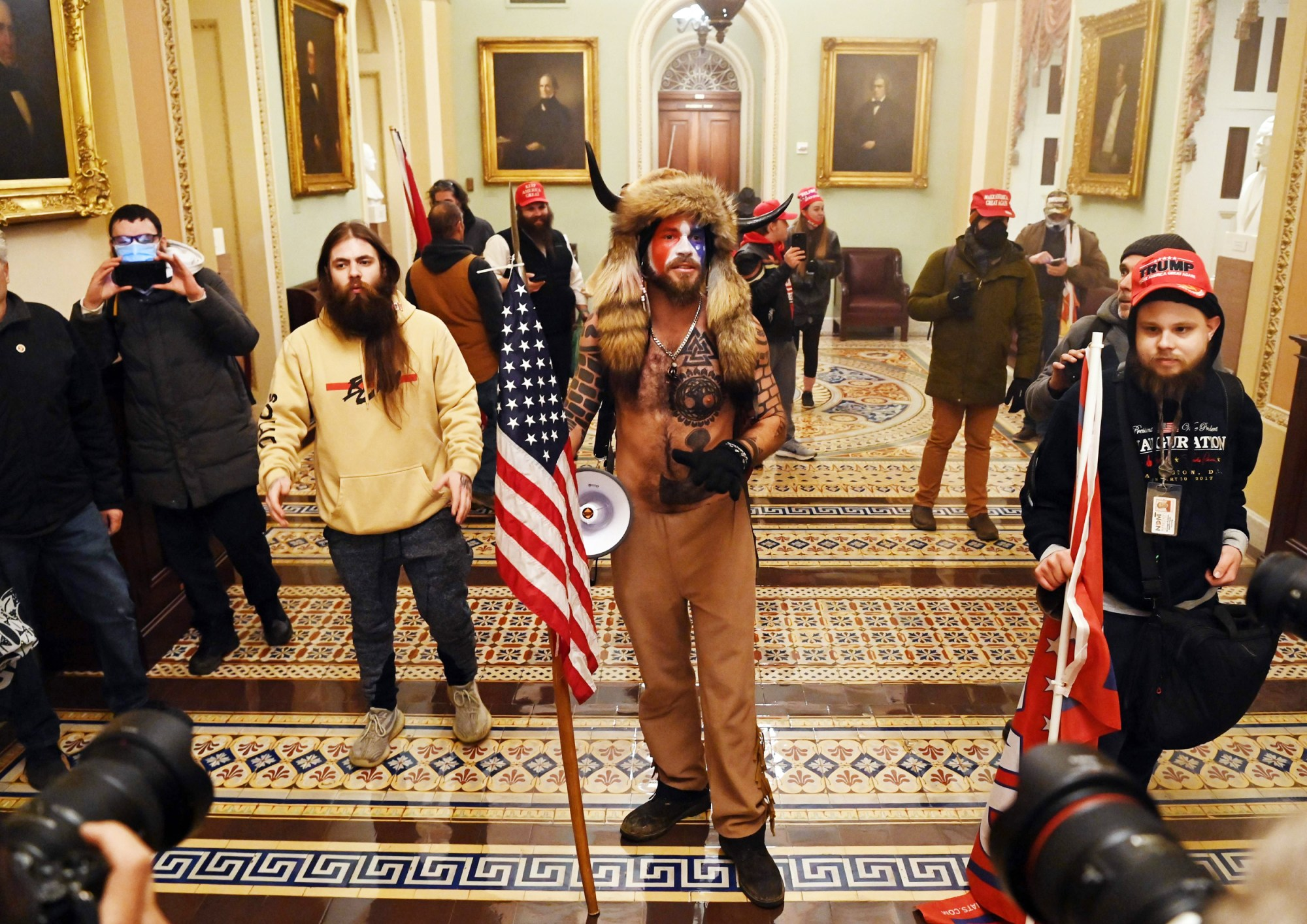 Trump-supporters pose for photos during US Capitol riot. January 6, 2021