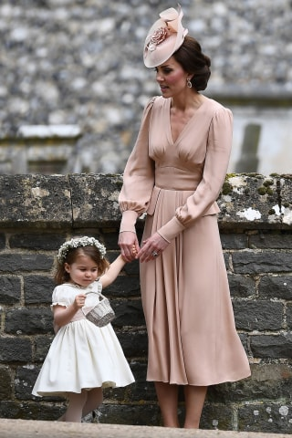 Pippa middleton wedding see what bride and sister kate middleton wore duchess kate stands with her daughter princess charlotte following the wedding of her sister pippa middleton to james matthews afpgetty images junglespirit Image collections