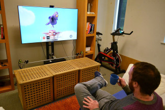 Image: Lancaster University researcher Christopher Clarke selects a channel to watch by using his mug as a remote control.