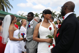 Image: Couples participate in a group Valentine's day wedding ceremony