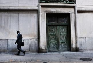 Image: A man walks through Manhattan's financial district