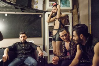 Image: Omar, second right, sits in the dressing room during the Mr. Gay Syria contest in Istanbul