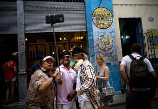 Image: Tourists take a selfie at the Bodeguita Del Medio bar in Havana