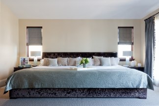 King Size Bedroom. This 12 foot mattress is double the size of a traditional king bed  Ace Collection family from feet wide