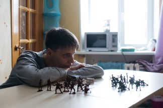 Image: Sasha Phoenix, 48, staring at an army of toy soldiers she used to play with as a child.