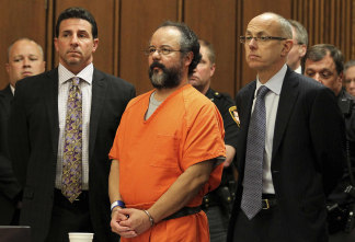 Image: Ariel Castro, 53, stands between attorneys Craig Weintraub and Jaye Schlachet as his sentence is read to him by judge Michael J. Russo in the courtroom in Cleveland