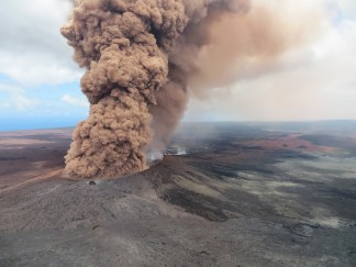 Image: A plume of ash rises from a crater in the Mount Kilauea volcano on May 4, 2018