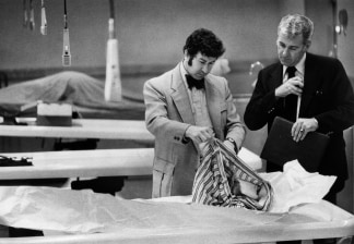 Image: Detectives go through the clothing of a murder victim